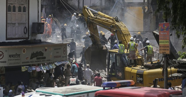 Rescuers at India building collapse find 15 injured, 33 dead