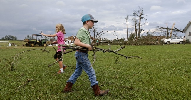 Floods and apparent tornado damage as Harvey hits Deep South