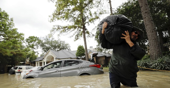 Houston's flood zone, by boat: Guinea pigs, guns and despair