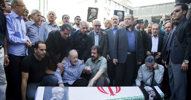 Hundreds attend funeral of Iranian dissident politician
