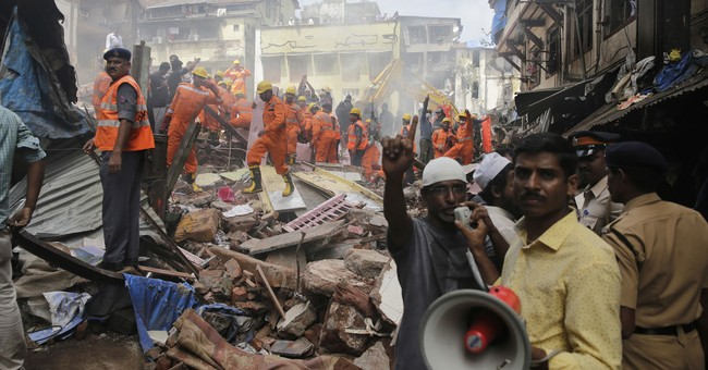 Rescuers end search at collapsed Mumbai building; 33 dead