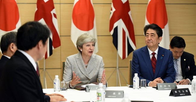 UK's May reassures on Brexit, backs Japan on North Korea