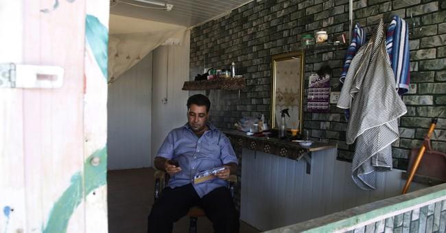 Syrians adapt to exile in Jordan's 5-year-old Zaatari camp
