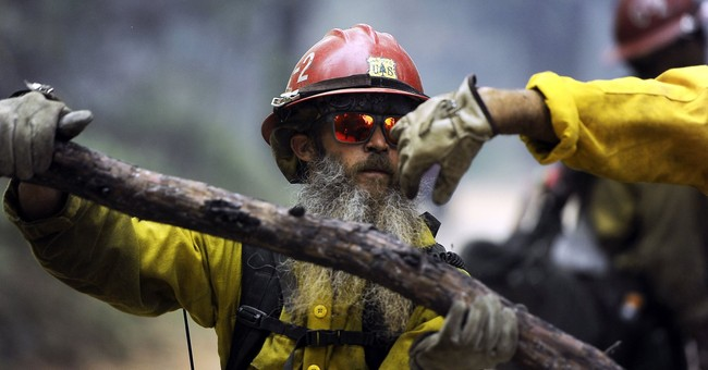 Triple-digit heat hampers fight against western US wildfires