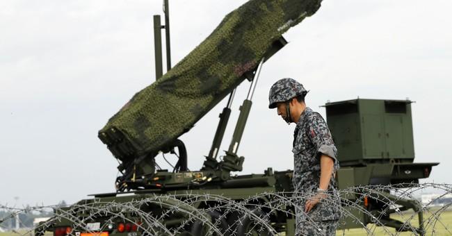 NKorea missile fear sets pre-emptive strike debate in Japan