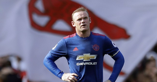 Police charge Wayne Rooney with drunk driving