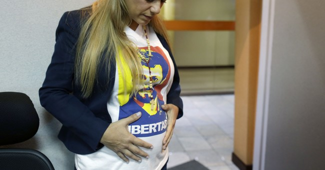Venezuela probes wife of opposition's Lopez for cash in car