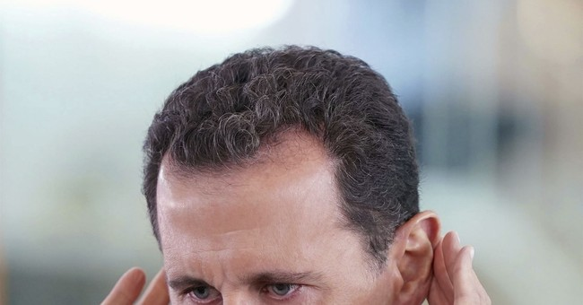 Syria president travels to newly captured town for prayers