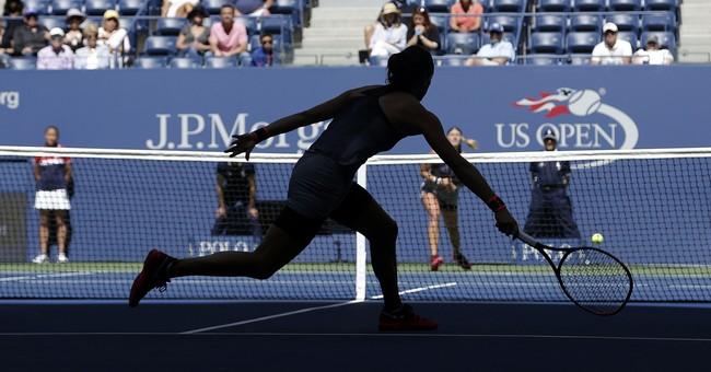 The Latest: Sharapova through to US Open round of 16
