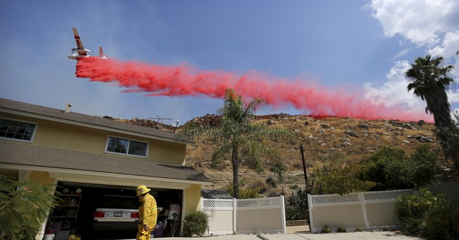 The Latest: Brush fire forces Burbank residents from homes
