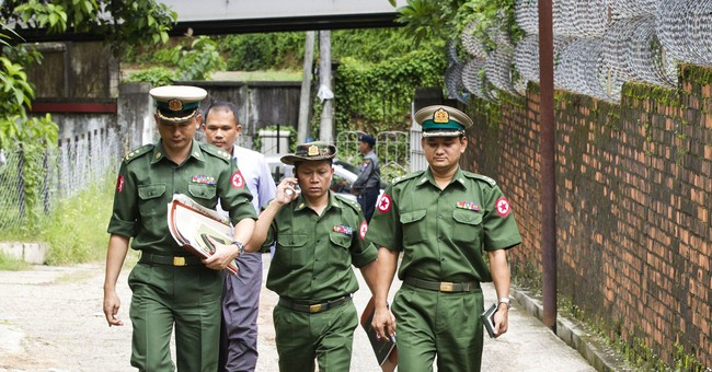 Myanmar military drops charges against 6 journalists