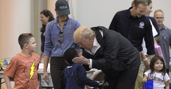 Enthusiastic Trump meets with storm victims
