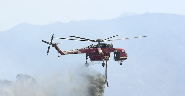 Weekend of record heat, wildfires eases for some In US West
