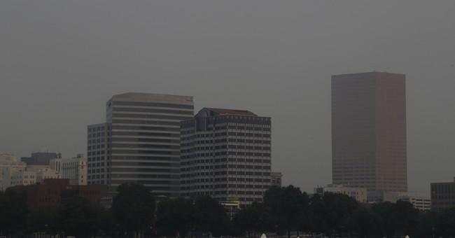 Ash covers Oregon cities, wildfire smoke chokes US West