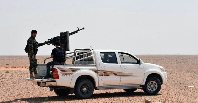 The Latest: Russia welcomes Syrian breach of IS siege