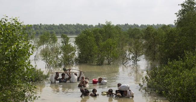 Aid groups struggle as more Rohingya flood into Bangladesh