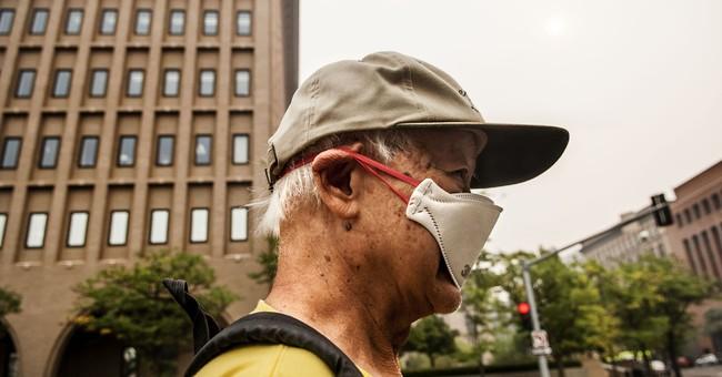 Late-season wildfires choke US cities, towns with smoke