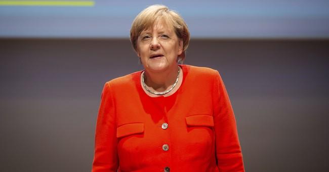 German police investigating after tomatoes thrown at Merkel