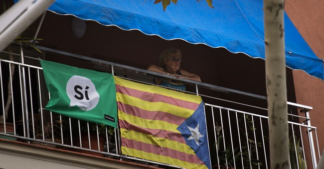 The Latest: Catalonia sets independence vote for Oct. 1