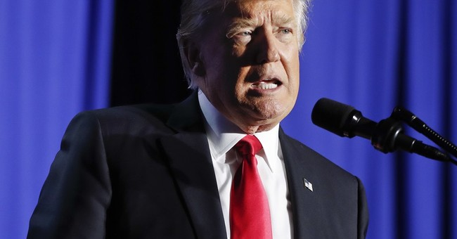 Trump moves to 'build that wall' with Mexico, curb refugees