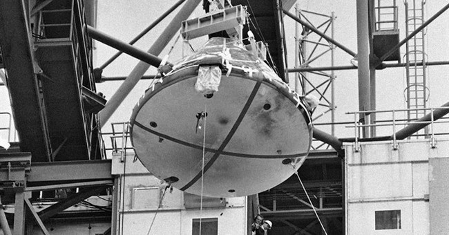 NASA displays Apollo capsule hatch 50 years after fatal fire