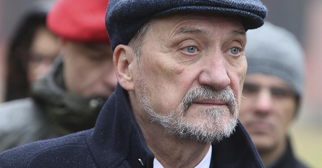 Poland's defense minister uninjured in 8-car collision