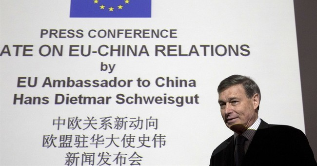 EU asks China to open markets following free trade support