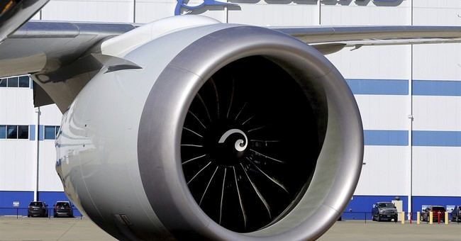 Boeing sees more airliner deliveries, lower defense revenue