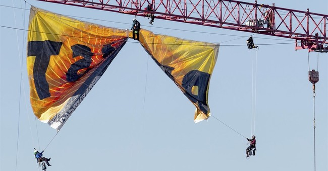 The Latest: Activists descending from crane near White House