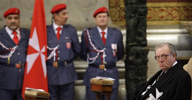 Pope takes over Knights of Malta after condom dispute