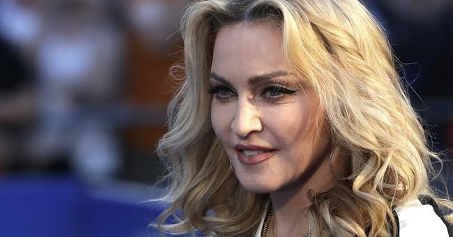 Madonna denies Malawi report she plans more adoptions