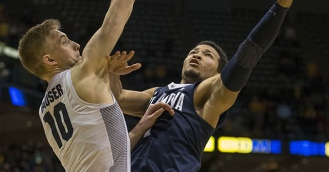 3 of top 4 teams in college hoops poll lose on same night