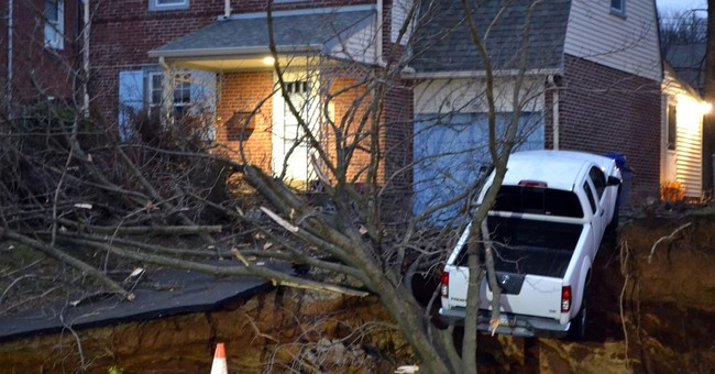 Sinkhole swallows yards, threatens pickup in Philly suburb