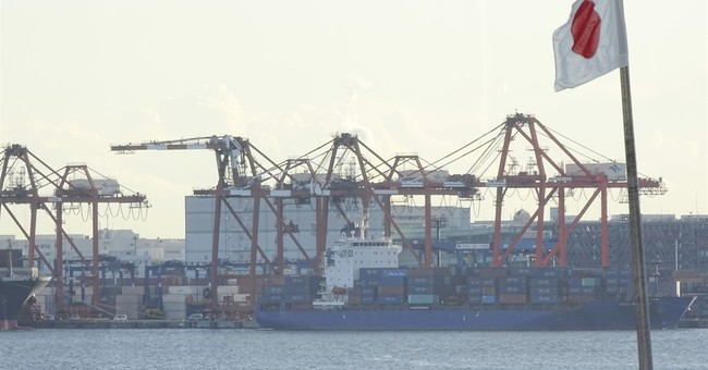 Japan sees 1st trade surplus on cheaper oil, China rebound
