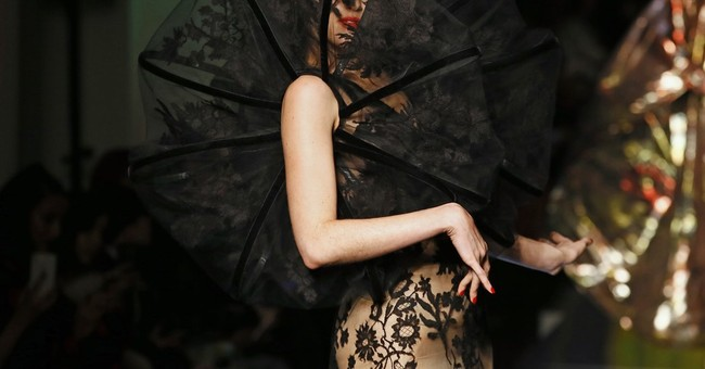 Valentino designer in solo couture debut; Gaultier goes acid