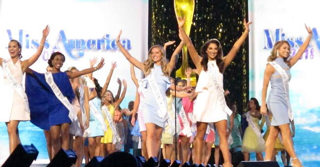 The Latest: Miss America names winners for talent, swimsuit