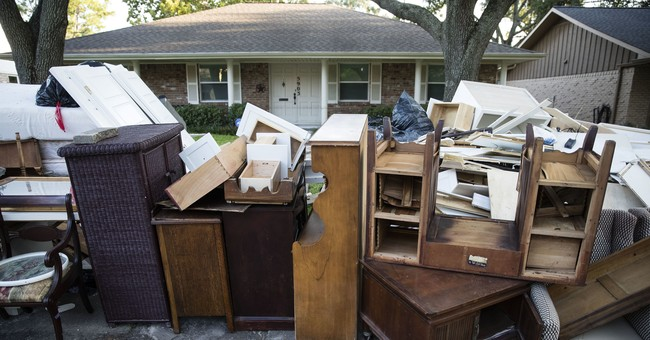 Harvey's floodwaters give way to festering piles of garbage