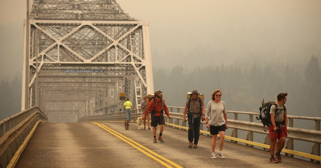 Wildfire smoke is choking the West but helping firefighters