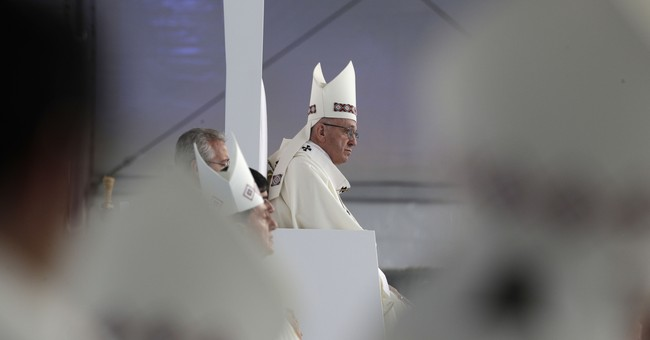 Pope embraces Colombian victims, ex-fighters in peace bid