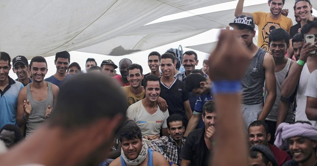 The Latest: UN urges Greece to improve migrant conditions