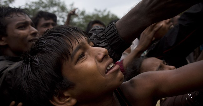 The Latest: India urges Myanmar to act with restraint