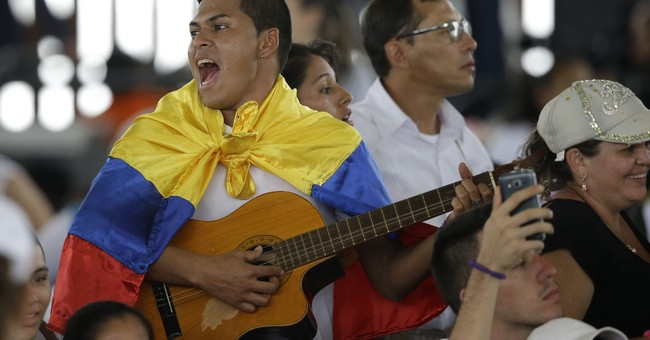 The Latest: Pope hears from victims of Colombia conflict
