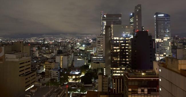 The Latest: Pemex: Fuel supplies stable despite quake, storm