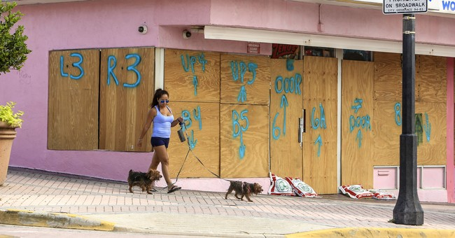 The Latest: Irma inland near Tampa, still Category 2 storm
