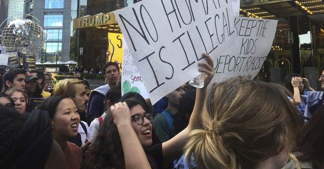 Hundreds protest immigration order outside Trump hotel