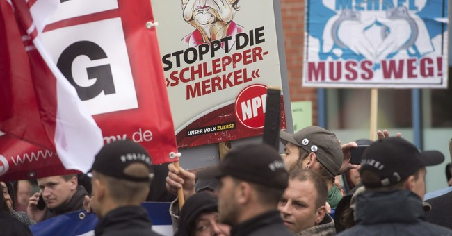 Merkel criticizes hecklers in German election campaign