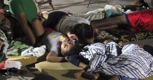 The Latest: Mexico quake death toll rises to 64