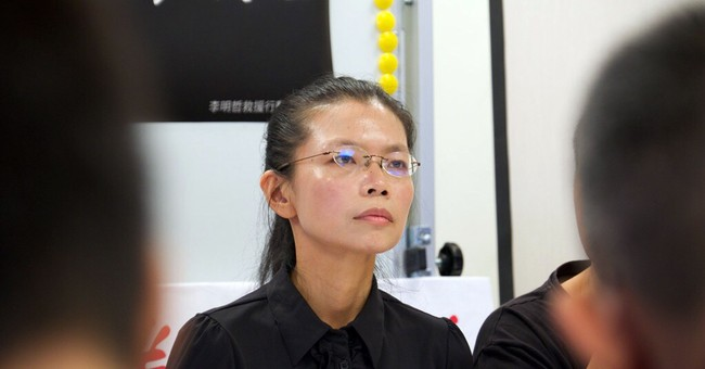Wife: Taiwan activist may be forced to plead guilty in China