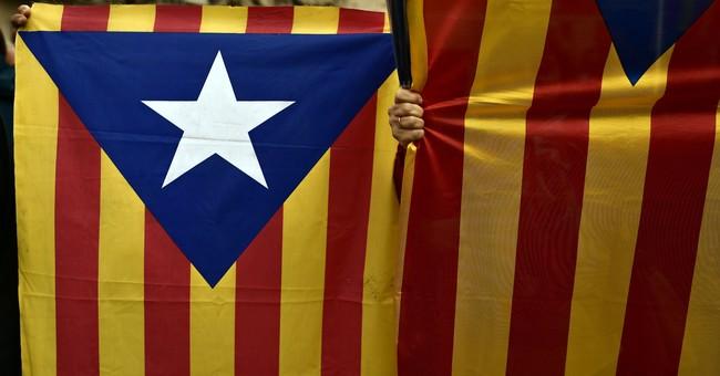 Spanish police raids aim to halt Catalan independence vote