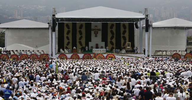 Pope recalls Medellin's bloody past, prays for drug victims